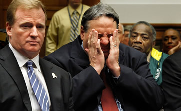 Former National Football League player Brent Boyd (C) rubs his head while sitting next to NFL Commissioner Roger Goodell (L) during a hearing of the House Judiciary Committee about football brain injuries on Captiol Hill October 28, 2009 in Washington, DC. A recent study of retired players suggested that N.F.L. retirees ages 60 to 89 are experiencing moderate to severe dementia at several times the national rate. Boyd suffers from headaches, depression, fatigue and dizziness caused by what his doctors diagnosed as post-concussion syndrome.